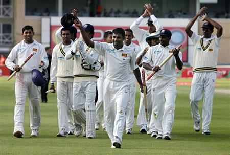 Muralitharan celebrates after taking eight wickets