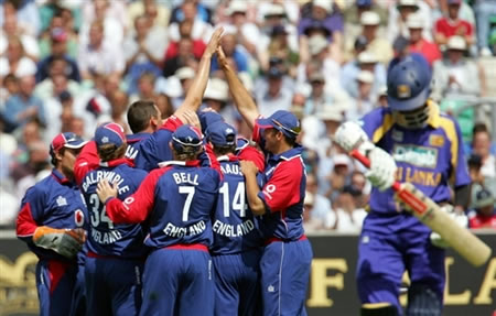 England cricketers celebrate the wicket of Tharanga